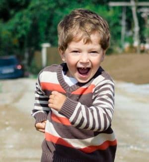 boy running towards his fun playful parent