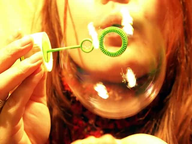 Child blowing bubbles for mindfulness meditation breathing exercise for kids